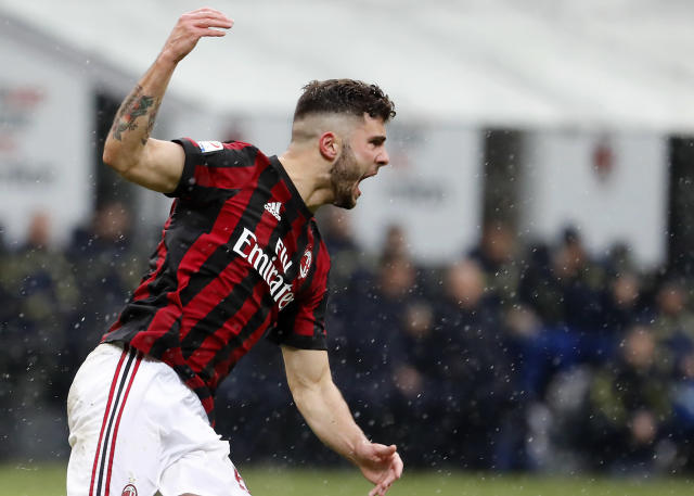 AC Milan's Patrick Cutrone celebrates after scoring his side's second goal during the Serie A soccer match between AC Milan and Chievo Verona at the San Siro stadium in Milan, Italy, Sunday, March 18, 2018. (AP Photo/Antonio Calanni)