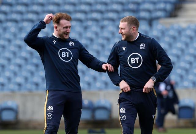 Stuart Hogg (left) and Finn Russell (right) are set to miss the Murrayfield fixture