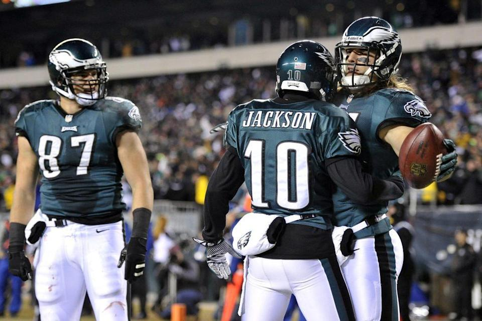 Jan 4, 2014; Philadelphia, PA, USA; Philadelphia Eagles wide receiver Riley Cooper (14) celebrates a touchdown catch with teammate DeSean Jackson (10) against the New Orleans Saints during the first half 2013 NFC wild card playoff football game at Lincoln Financial Field. Mandatory Credit: Joe Camporeale-USA TODAY Sports