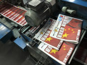 """Copies of Apple Daily's July 1, 2020, edition are seen with its front page title of """"Draconian law is effective, one country two system is dead"""" at the newspaper's printing house in Hong Kong on July 1, 2020. A year ago, the pro-democracy Apple Daily newspaper published a front-page headline saying Hong Kong's governing principle of """"one country, two systems is dead."""" On Thursday, June 17, 2021, the newspaper was facing its greatest peril. Three top editors and two senior executives were arrested under Hong Kong's new national security law. (AP Photo/Vincent Yu, File)"""