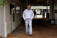 Trainer Steve Asmussen looks out from his barn after a workout at Churchill Downs Wednesday, April 28, 2021, in Louisville, Ky. The 147th running of the Kentucky Derby is scheduled for Saturday, May 1. (AP Photo/Charlie Riedel)