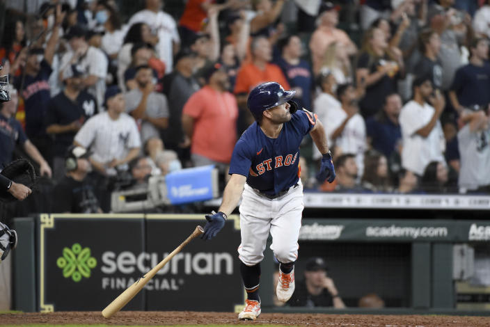 Houston Astros' Jose Altuve watches his game-winning three-run home run during the ninth inning of a baseball game against the New York Yankees, Sunday, July 11, 2021, in Houston. (AP Photo/Eric Christian Smith)