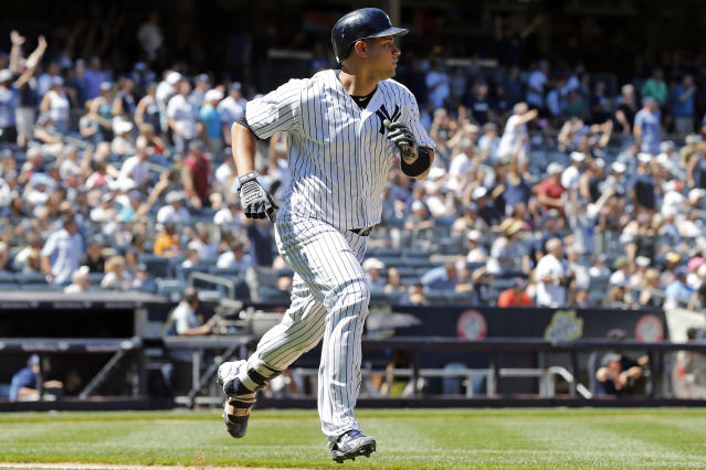 New York Yankees' Gary Sanchez watches his solo home run as he runs up the first baseline during the fifth inning of a baseball game against the Tampa Bay Rays on Saturday, June 16, 2018, in New York. (AP Photo/Adam Hunger)