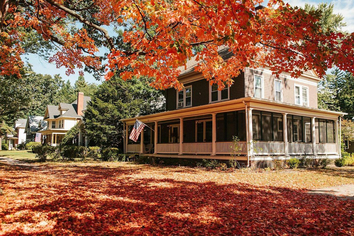 home with fall foliage in yard