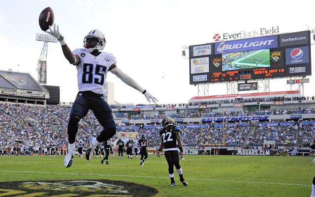 Tennessee Titans wide receiver Nate Washington (85) jumps after scoring a touchdown against the Jacksonville Jaguars on a 30-yard pass play during the second half of an NFL football game in Jacksonville, Fla., Sunday, Dec. 22, 2013. (AP Photo/Stephen Morton)
