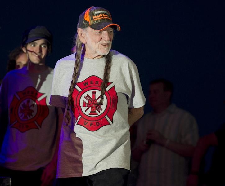 "Willie Nelson takes the stage wearing an ""I Support West VFD"" T-shirt at his performance at The Backyard Live Oak Amphitheater in Austin, Texas, on Sunday, April 28, 2013. The concert was an early birthday celebration for Nelson, who turns 80 on Tuesday, and it was a benefit for the volunteer fire department in West, Texas, which is nearby where Nelson grew up in Abbott, Texas. A fertilizer plant exploded April 17 killing at least 14 people, including emergency responders, and hurting about 200 others. (AP Photo/Austin American-Statesman, Jay Janner) AUSTIN CHRONICLE OUT, COMMUNITY IMPACT OUT, MAGS OUT; NO SALES; INTERNET AND TV MUST CREDIT PHOTOGRAPHER AND STATESMAN.COM."