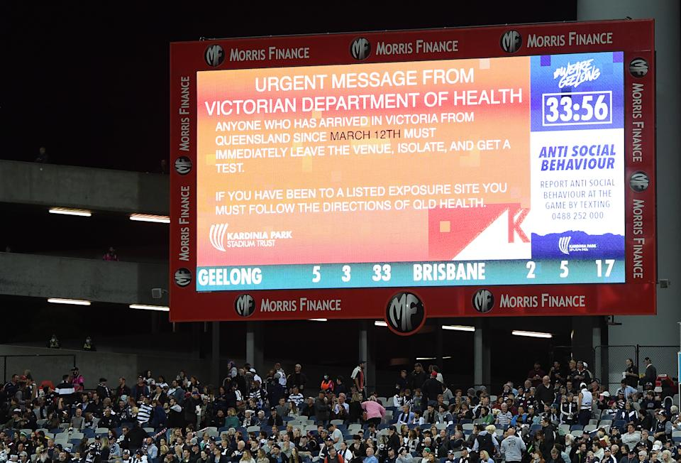 A health warning is put up on the big screen during the round 2 AFL match between the Geelong Cats and the Brisbane Lions at GMHBA Stadium on March 26, 2021 in Geelong, Australia.