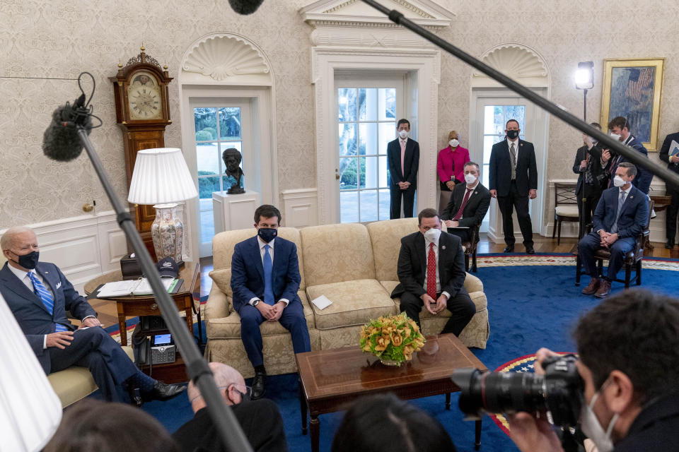 From left, President Joe Biden, Transportation Secretary Pete Buttigieg, House Transportation and Infrastructure Committee Ranking Member Rep. Sam Graves, R-Mo., Rep. Brian Fitzpatrick, R-Pa., Highways and Transit Subcommittee Ranking Member Rep. Rodney Davis, R-Ill., and other members of the House of Representatives meet in the Oval Office of the White House in Washington, Thursday, March 4, 2021, on infrastructure.  (AP Photo/Andrew Harnik)