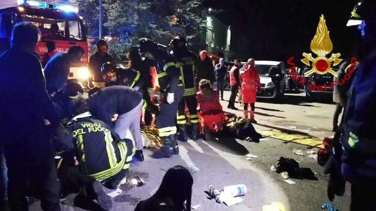 This handout picture taken and released  y the Italian fire and rescue service shows emergency personnel treating victims after the stampede in Corinaldo