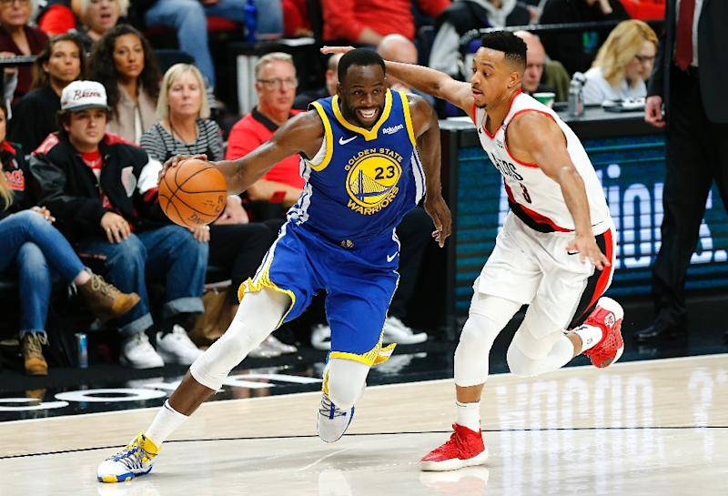 Triple-double: Golden State's Draymond Green drives past Portland's CJ McCollum in the Warriors' 110-99 victory over the Trail Blazers in game three of the NBA Western Conference finals