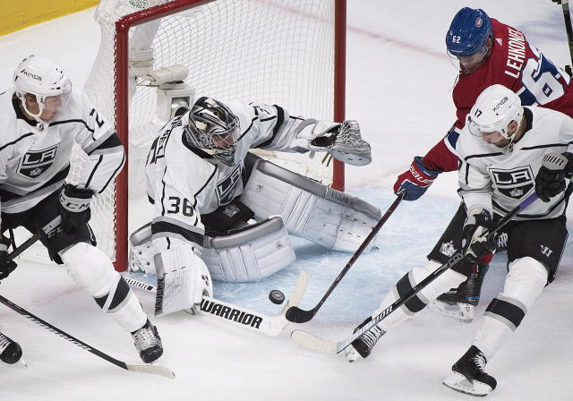 Los Angeles Kings goaltender Jack Campbell makes a save against Montreal Canadiens' Arturri Lehkonen (62) as Kings' Ilya Kovalchuk (17) and Paul LaDue defend during the first period of an NHL hockey game Thursday, Oct. 11, 2018, in Montreal. (Graham Hughes/The Canadian Press via AP)