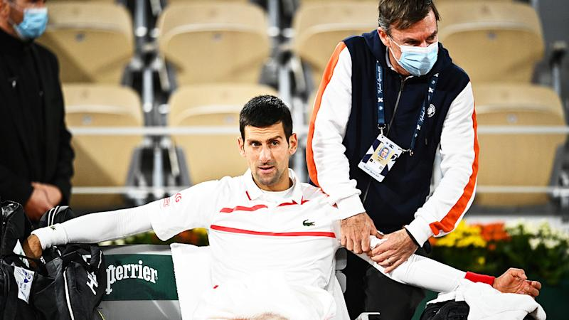 Novak Djokovic is pictured getting treatment on his shoulder during a medical timeout at the French Open.