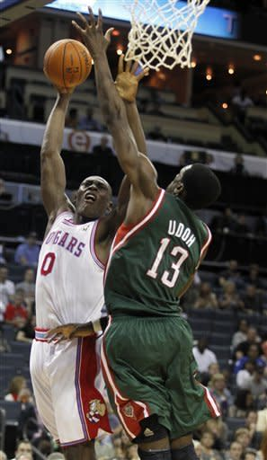 Charlotte Bobcats' Bismack Biyombo (0) shoots the basketball over Milwaukee Bucks' Ekpe Udoh (13) in the first half of an NBA basketball game in Charlotte, N.C. , Friday, March 23, 2012. (AP Photo/Bob Leverone)