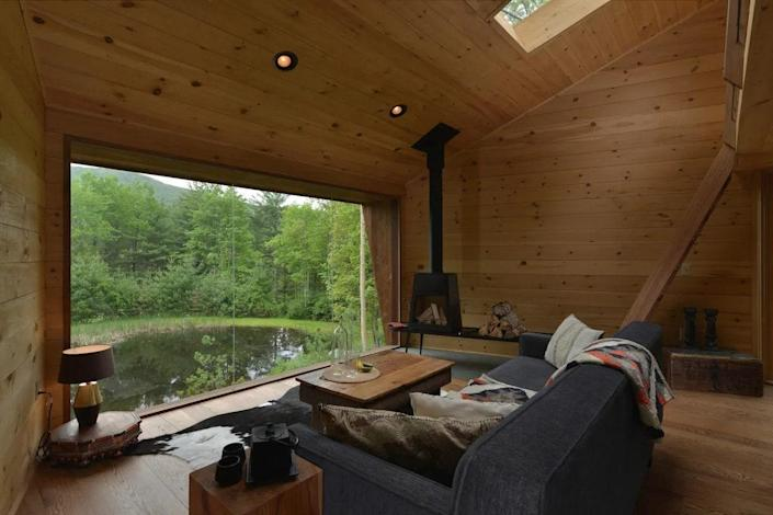 """<p><strong>Willow, New York</strong></p> <p>The Catskills are known for having a plethora of intimate, rustic lodgings, and the Willow Treehouse doesn't disappoint. The modern build of the treehouse was designed by Antony Gibbon and built by William Johnson. The huge floor-to-ceiling windows in the living room and the bedroom overlook the woods and the swimmable pond, and there's a full kitchen with a modern aesthetic, if your travel crew likes to prep at home. Don't forget to soak in the wood-burning hot tub.</p> $382, Airbnb. <a href=""""https://www.airbnb.com/rooms/13761529"""" rel=""""nofollow noopener"""" target=""""_blank"""" data-ylk=""""slk:Get it now!"""" class=""""link rapid-noclick-resp"""">Get it now!</a>"""