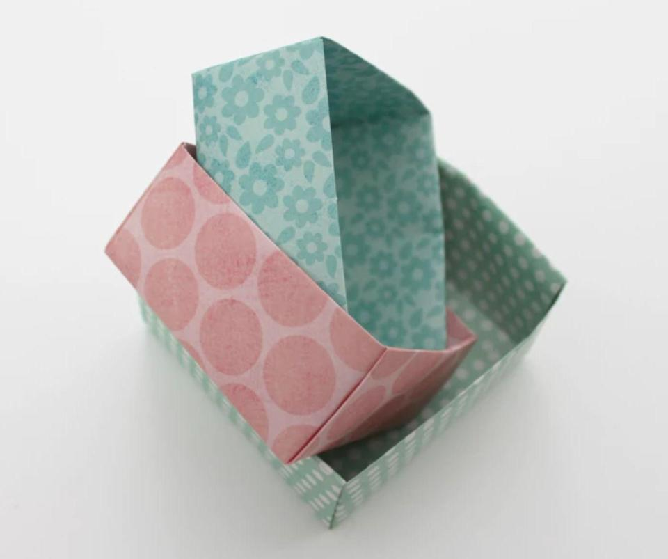 "<p>Turn a pretty sheet of paper into a catchall box with so many uses during the holiday season. Fill them with candies or snacks, use them as gift boxes, or even set up an activity station for holiday crafting when celebrating with loved ones.</p><p><em><a href=""https://www.whitehousecrafts.net/post/2016/02/25/how-to-make-an-origami-catchall-box"" rel=""nofollow noopener"" target=""_blank"" data-ylk=""slk:Get the tutorial at White House Crafts»"" class=""link rapid-noclick-resp"">Get the tutorial at White House Crafts»</a></em><br></p>"