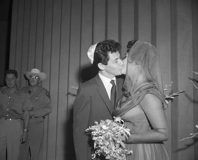 Eddie Fisher and Elizabeth Taylor kiss after marrying in Las Vegas on May 12, 1959. Earlier in the day, Fisher had obtained his divorce from Debbie Reynolds. (Photo: Getty Images)