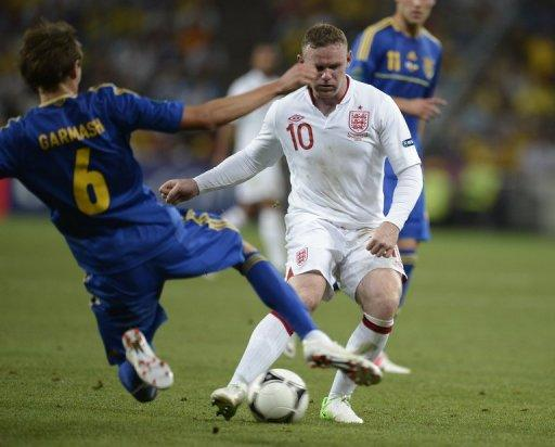 A goal by the recalled Wayne Rooney - thanks to a howler by the Ukrainian goalkeeper - was enough for England