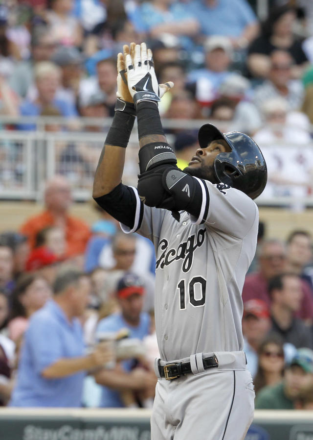 Chicago White Sox's Alexei Ramirez gestures after hitting a two-run home run off Minnesota Twins starting pitcher Logan Darnell during the fifth inning of a baseball game in Minneapolis, Saturday, July 26, 2014. (AP Photo/Ann Heisenfelt)