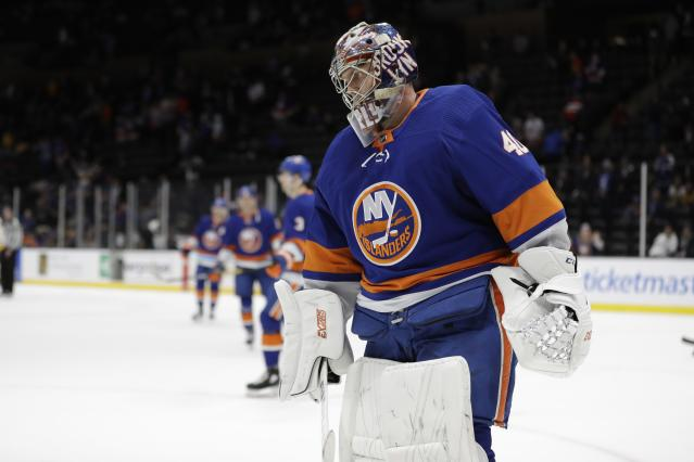 New York Islanders goaltender Semyon Varlamov (40) leaves the ice with teammates after an NHL hockey game against the Nashville Predators Tuesday, Dec. 17, 2019, in Uniondale, N.Y. The Predators won 8-3. (AP Photo/Frank Franklin II)