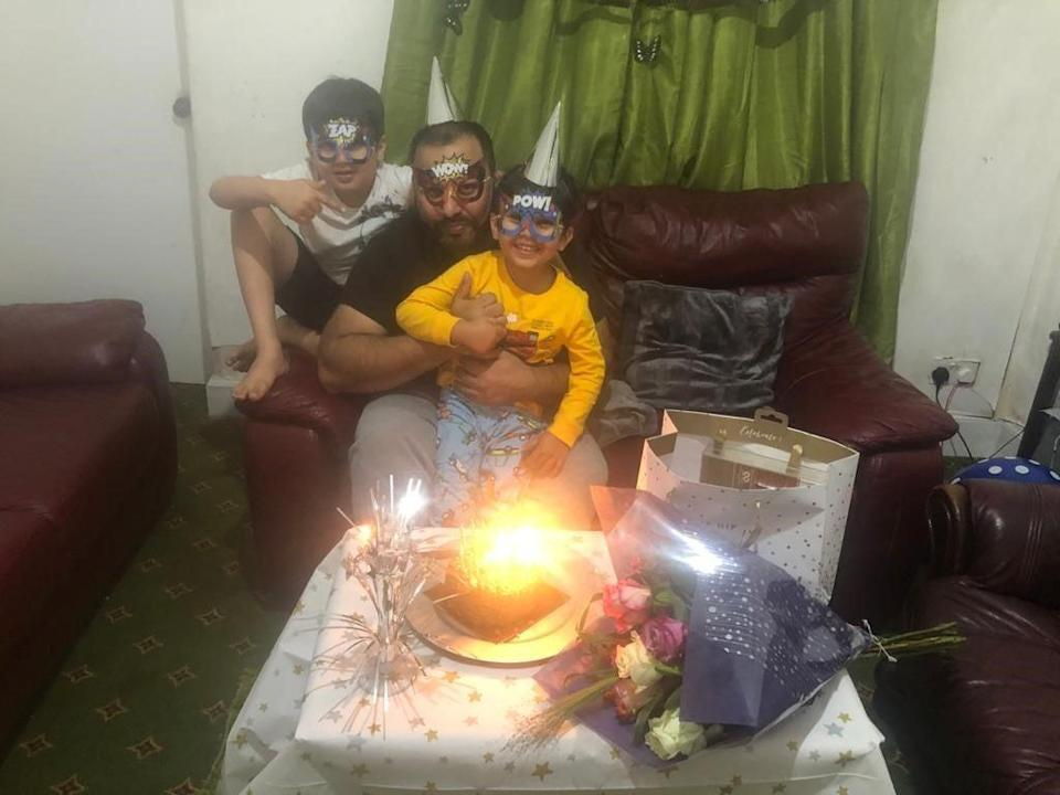Asim Riaz and his two sons celebrate a birthday just weeks before their tragic trip to Loch Lomond (Iqra Riaz)