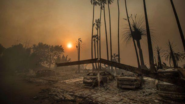 PHOTO: Smoke rises behind a leveled apartment complex as a wildfire burns in Ventura, Calif., Dec. 5, 2017 (Noah Berger/AP)