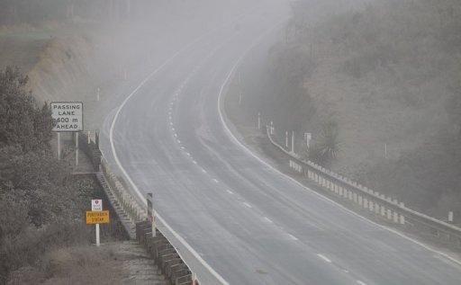 File photo of a road near Mount Tongariro coated with ash after the volcano erupted in August 2012. The mountain in the centre of the North Island was dormant for more than a century until August this year, when a massive blast ripped a new vent in its side and hurled boulders the size of cars more than two kilometres
