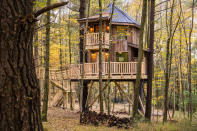This undated photo provided by The Mohicans Treehouse Resort and Wedding Venue shows one of the nine treehouses at The Mohicans Treehouse Resort and Wedding Venue in Glenmont, Ohio. (Chris McLelland via AP)