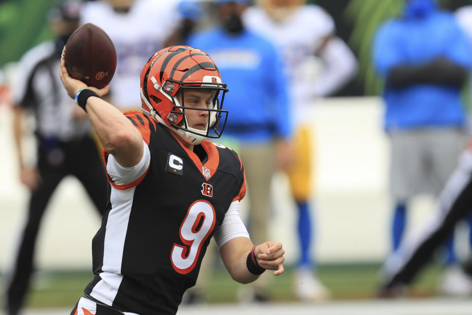 Cincinnati Bengals quarterback Joe Burrow (9) ran for a rushing touchdown in the first quarter of his debut. (AP Photo/Aaron Doster)
