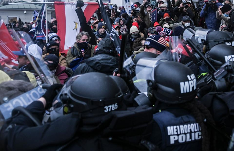 <p>Washington DC police and pro-Trump demonstrators clash at the United States Capitol during the Pro-Trump rally. </p><p> </p> (Rex Features)