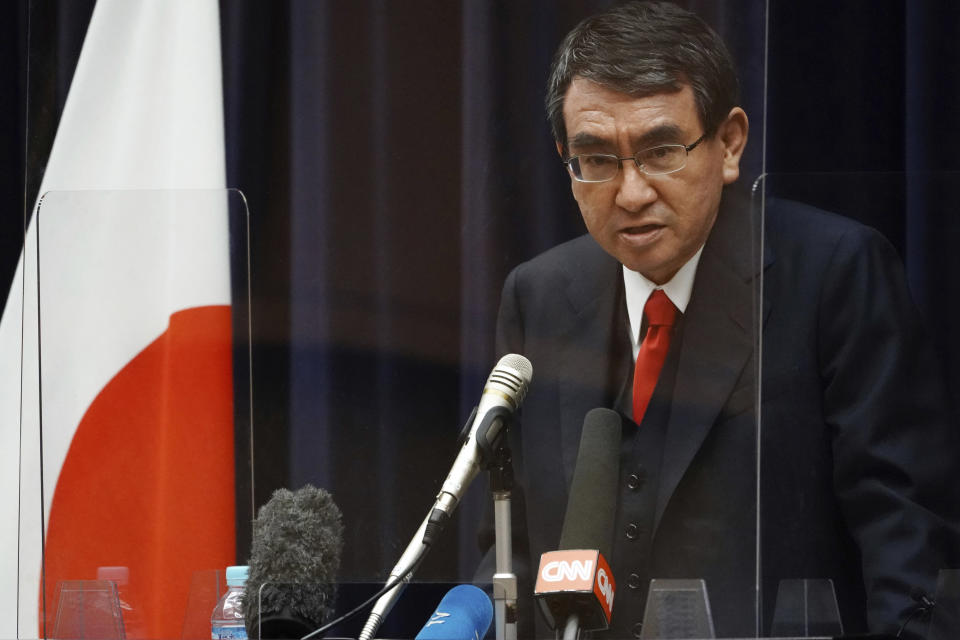 Japan's Administrative Reform Minister Taro Kono, who is also in charge of COVID-19 vaccines, speaks during a press conference ahead of COVID-19 inoculation Tuesday, Feb. 16, 2021, in Tokyo. Japan's COVID-19 vaccinations are scheduled to begin Wednesday. (AP Photo/Eugene Hoshiko)