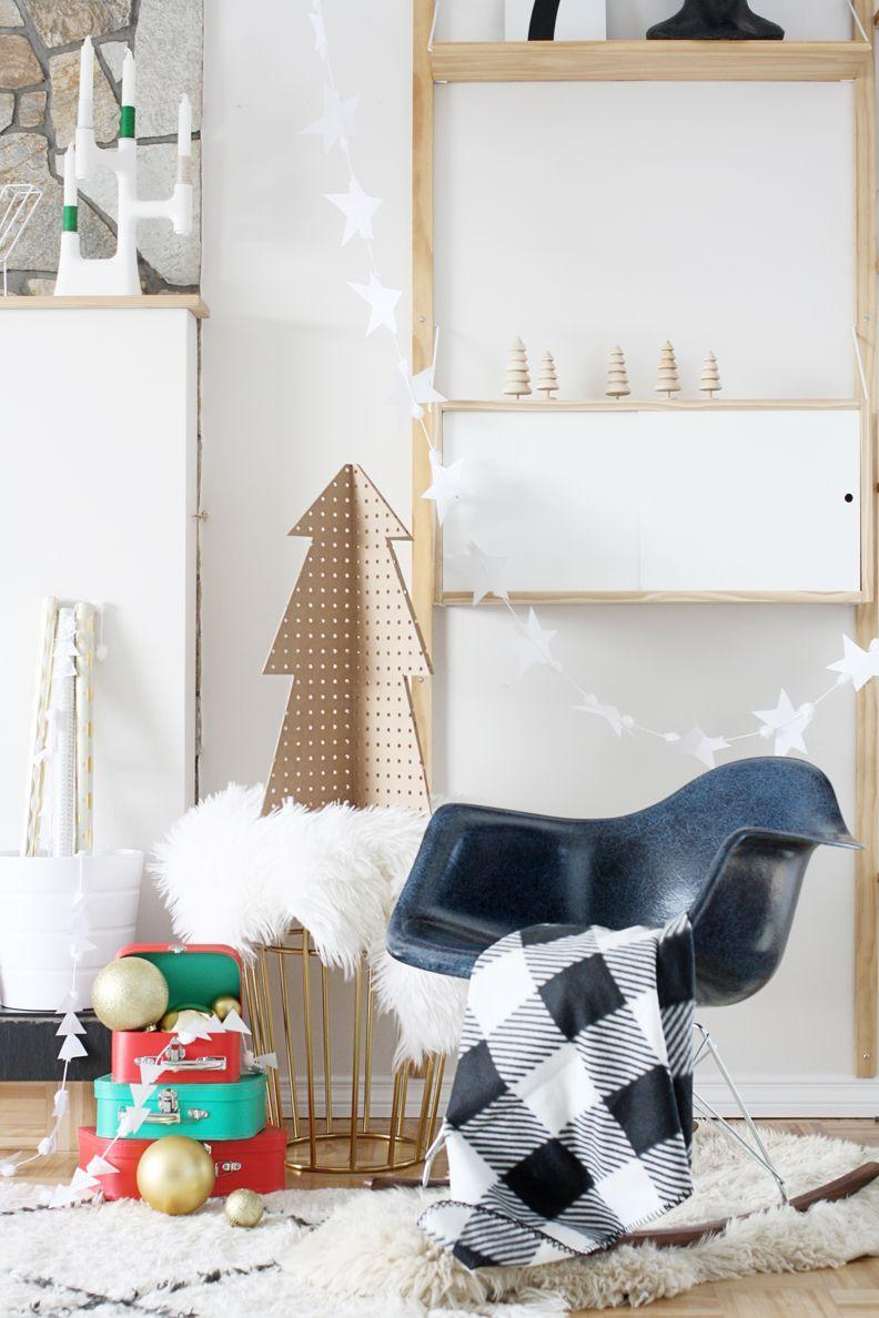 "<p>Hello, sheepskin and buffalo check. Break out your coziest textiles and your display will feel even more festive. </p><p>See more at <a href=""https://www.hellolidy.com/pegboard-christmas-tree/"" rel=""nofollow noopener"" target=""_blank"" data-ylk=""slk:Hello DIY"" class=""link rapid-noclick-resp"">Hello DIY</a>.</p>"