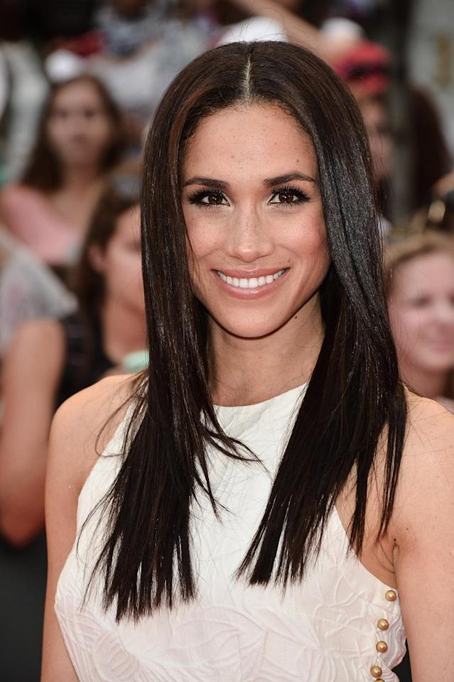 <p>Markle showed up to the 2013 MuchMusic Video Awards in Toronto with bone-straight strands and a bright smile. (Photo: George Pimentel/WireImage) </p>