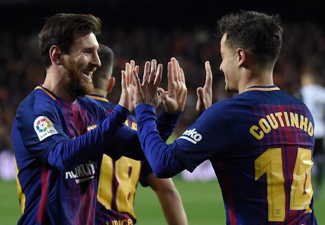 Barcelona's Philippe Coutinho (R) celebrates after scoring a goal with Lionel Messi during their Spanish Copa del Rey (King's Cup) second leg semi-final match against Valencia, at the Mestalla stadium in Valencia, on February 8, 2018 (AFP Photo/JOSE JORDAN )