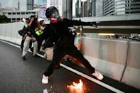 A protester throws a molotov cocktail towards police in Hong Kong's Admiralty district during pro-democracy demos on August 31, 2019