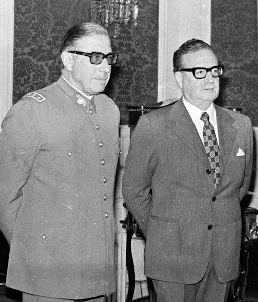 FILE - In this Aug. 23, 1973 file photo, Chilean Gen. Augusto Pinochet, left, and President Salvador Allende attend a ceremony naming Pinochet as commander in chief of the Army. As Chile marks the 40th anniversary of the coup led by Gen. Augusto Pinochet overthrowing Allende, on Wednesday, Sept. 11, 2013, Allende's legacy is thriving. A socialist is poised to reclaim the presidency and a new generation, born after the return to democracy in 1990 has taken to the streets in vast numbers to demand the sort of social goals Allende promoted. (AP Photo/Enrique Aracena, File)