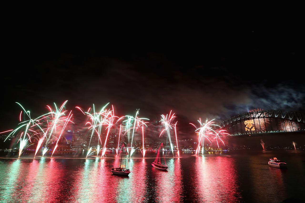 SYDNEY, AUSTRALIA - DECEMBER 31:  Fireworks light up the sky above the Sydney Harbour Bridge at midnight during New Years Eve celebrations on Sydney Harbour on December 31, 2012 in Sydney, Australia.  (Photo by Cameron Spencer/Getty Images)