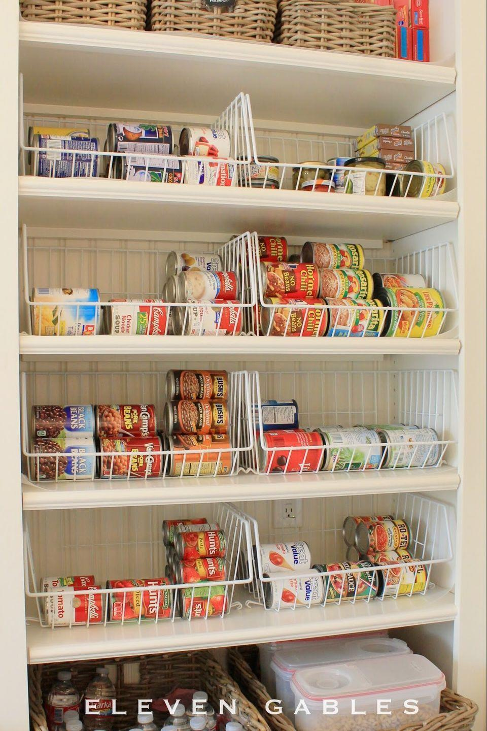 """<p>When stored on their sides, cans are stackable yet keep their labels in sight. Of course, you'll need to contain the sideways cans somehow —<span class=""""redactor-invisible-space""""> and these wire baskets are just the right thing for the job. Your organized pantry will thank you.</span></p><p><a href=""""http://www.elevengables.com/2014/07/eleven-gables-butler-pantry.html"""" rel=""""nofollow noopener"""" target=""""_blank"""" data-ylk=""""slk:See more at Eleven Gables »"""" class=""""link rapid-noclick-resp""""><em>See more at Eleven Gables »</em></a></p>"""