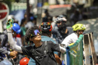 A protester prepares to throw a part of banana towards the police during a protest against the military coup in Yangon, Myanmar, Tuesday, March 2, 2021. Demonstrators in Myanmar took to the streets again on Tuesday to protest last month's seizure of power by the military, as foreign ministers from Southeast Asian countries prepared to meet to discuss the political crisis. Police in Yangon, Myanmar's biggest city, used tear gas against the protesters. (AP Photo)