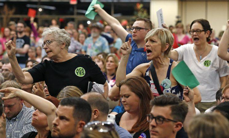 Audience members stand up to shout down Arizona Republican Sen. Jeff Flake during a town hall in April 2017 in Mesa, Ariz. (Photo: Ross D. Franklin/AP)