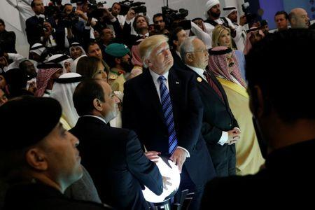 U.S. President Donald Trump and other leaders including Egypt's President Abdel Fattah al-Sisi (bottom, 2nd L) and Malaysia's Prime Minister Najib Razak (4th R) react to a wall of computer screens coming online as they tour the Global Center for Combatting Extremist Ideology in Riyadh, Saudi Arabia May 21, 2017. REUTERS/Jonathan Ernst