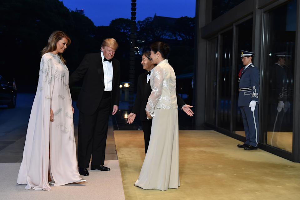First Lady Melania Trump, left, and U.S. President Donald Trump, second left, are greeted by Japan's Emperor Naruhito, second right and Japan's Empress Masako, as they arrive at the Imperial Palace for a state banquet in Tokyo, Japan [Photo: Getty]