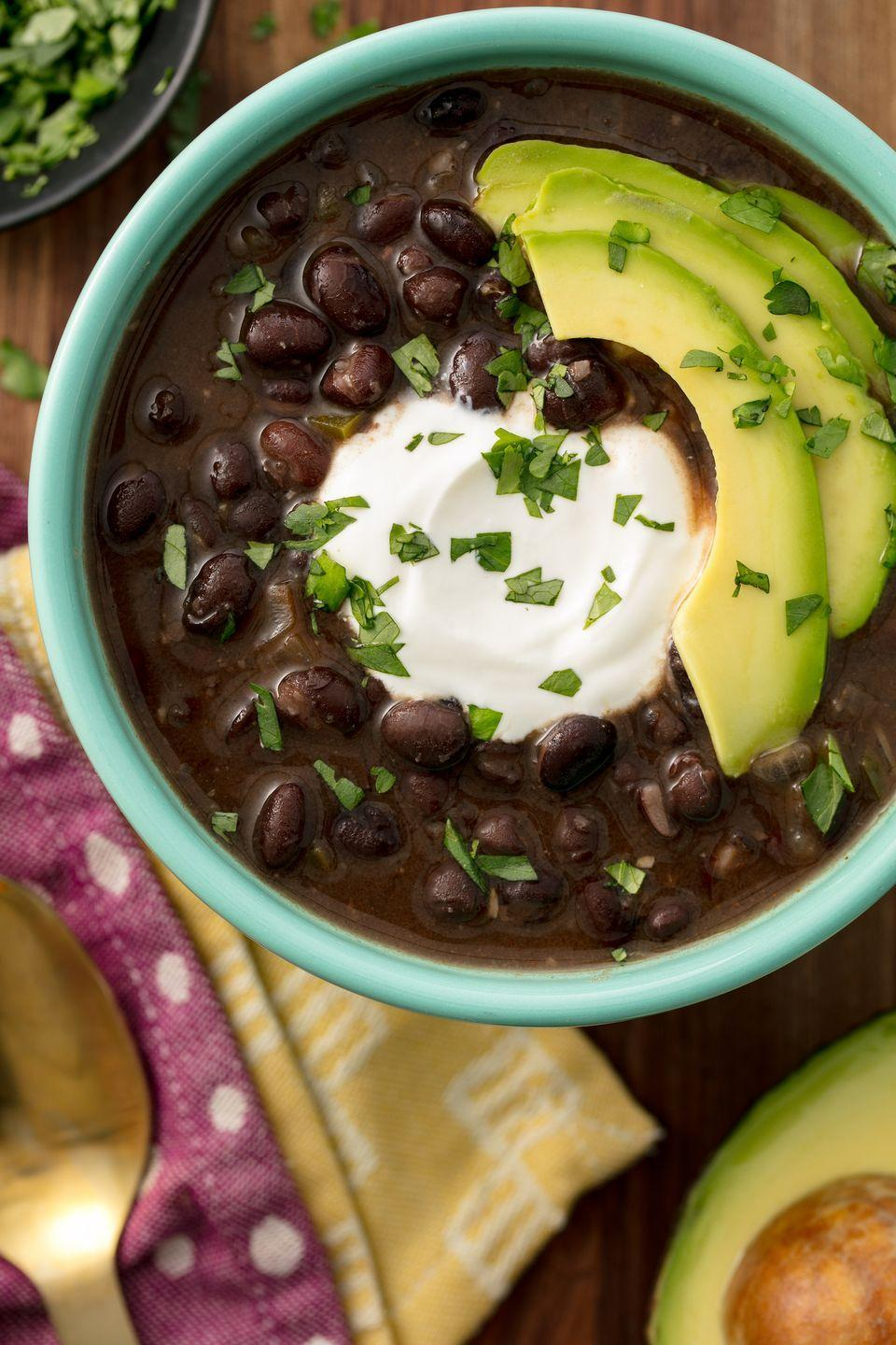 "<p>A warm and spicy black bean soup.</p><p>Get the recipe from <a href=""https://www.delish.com/cooking/recipe-ideas/recipes/a55504/easy-black-bean-soup-recipe/"" rel=""nofollow noopener"" target=""_blank"" data-ylk=""slk:Delish"" class=""link rapid-noclick-resp"">Delish</a>.</p>"