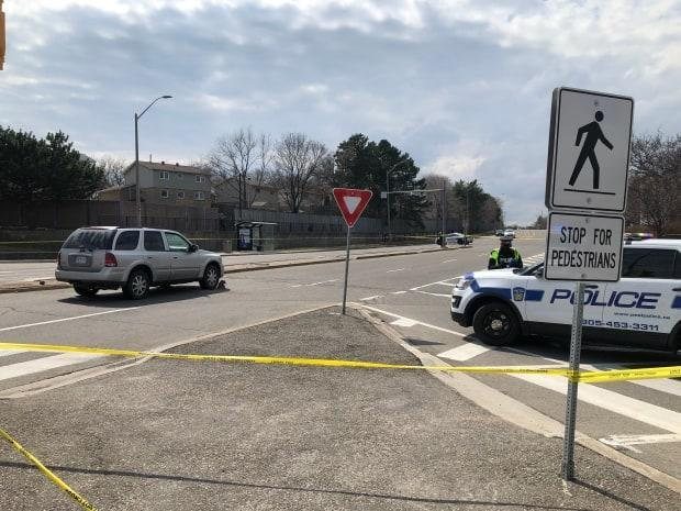 Peel Regional Police were called to the scene in the Erin Mills Parkway and Battleford Road area just before 1:15 p.m. for reports that a child was struck.  (Oliver Walters/CBC - image credit)