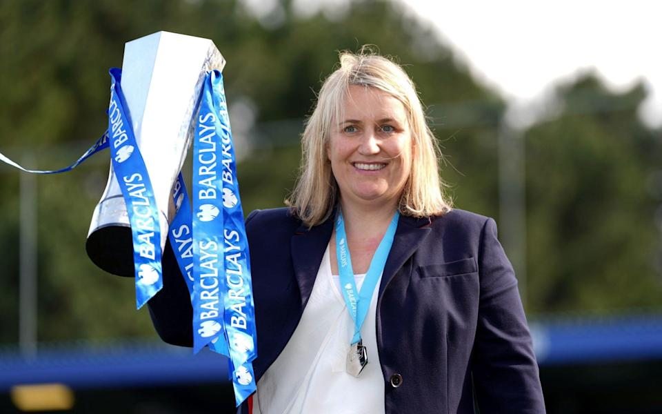 Chelsea manager Emma Hayes celebrates with the FA Women's Super League trophy after clinching the title at Kingsmeadow, London. - PA