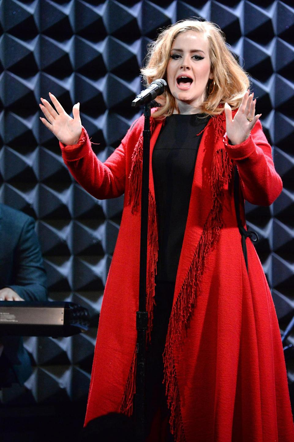 <p>Obviously a fan of fringe, Adele also wore it, although a bit more subtly, to celebrate the release of her new album during a performance to small audience in New York. Wearing a black shirt and pants, she added flair and fun with a red robe coat. </p>