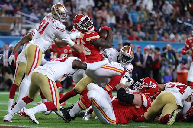 MIAMI, FLORIDA - FEBRUARY 02: Damien Williams #26 of the Kansas City Chiefs is tackled by Mike McGlinchey #69 of the San Francisco 49ers in the second quarter of Super Bowl LIV at Hard Rock Stadium on February 02, 2020 in Miami, Florida. (Photo by Tom Pennington/Getty Images)