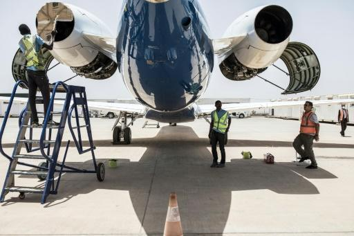 Transair's ground crew prepare a twin-jet Embraer for a one-hour technical flight, one of the few exceptions allowed under Senegal's anti-coronavirus restrictions