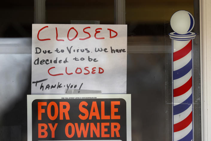"""For Sale By Owner"" and ""Closed Due to Virus"" signs are displayed in the window of Images On Mack in Grosse Pointe Woods, Mich., Thursday, April 2, 2020. The coronavirus outbreak has triggered a stunning collapse in the U.S. workforce with 10 million people losing their jobs in the past two weeks and economists warn unemployment could reach levels not seen since the Depression, as the economic damage from the crisis piles up around the world. (AP Photo/Paul Sancya)"