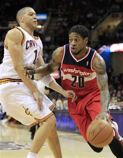 Washington Wizards' Cartier Martin (20) drives past Cleveland Cavaliers' Anthony Parker (18) in the first quarter in an NBA basketball game on Wednesday, April 25, 2012, in Cleveland. (AP Photo/Tony Dejak)