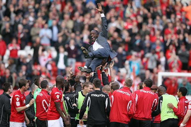 LONDON, ENGLAND - APRIL 21: Charlton Athletic's manager Chris Powell (C) celebrates his side's victory over Wycombe Wanderers at The Valley which sees them win the npower League One on April 21, 2012 in London, England. (Photo by Oli Scarff/Getty Images)